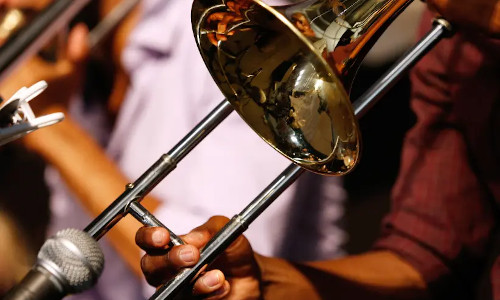 A musician plays a trombone during the first day of the New Orleans Jazz and Heritage Festival.